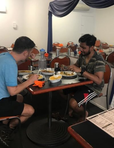 two men enjoying Spice Racks food at table